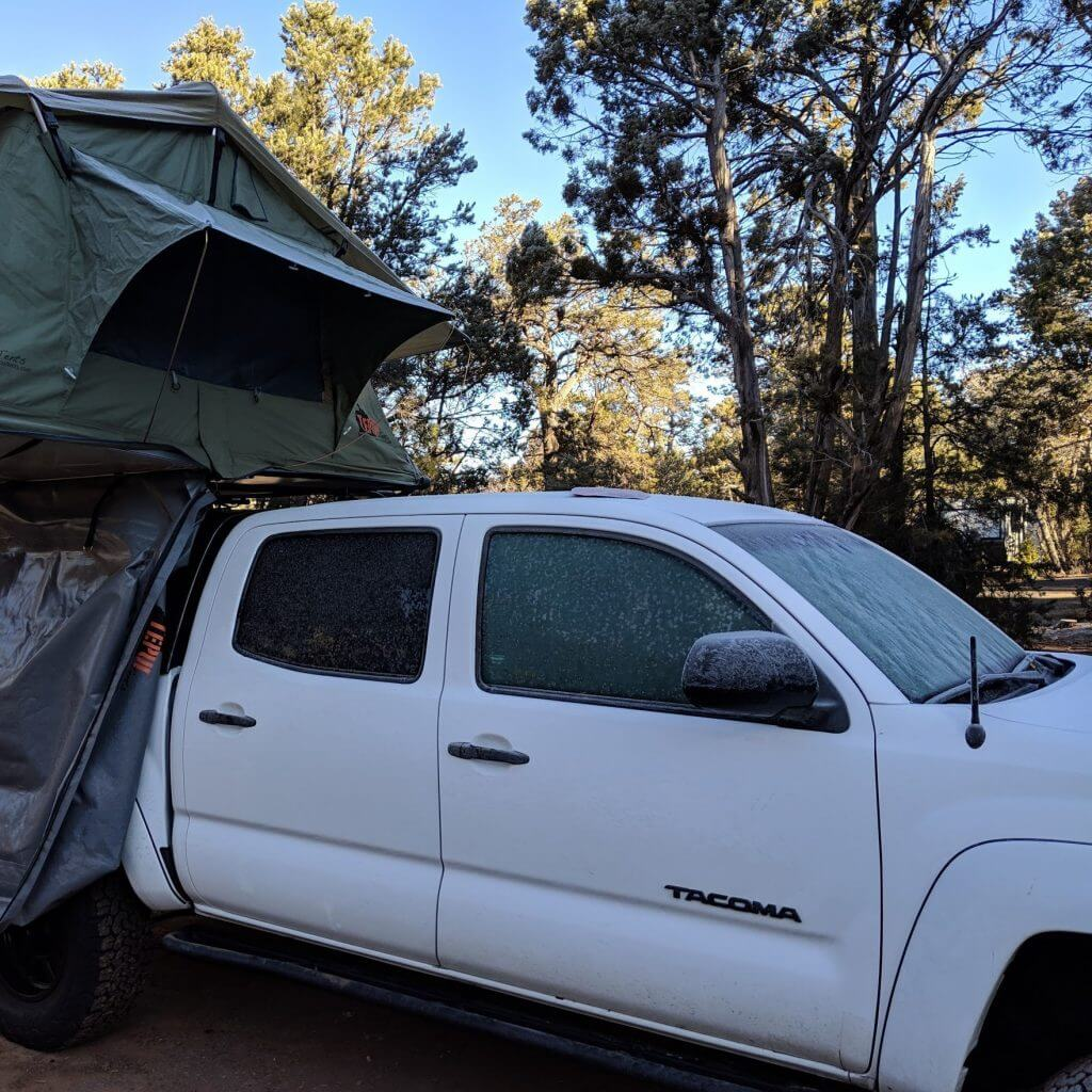 Walker in ice with a rooftop tent